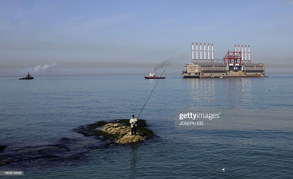 Karadeniz Powership Fatmagul Sultan docks at the newly set wave breaker in front of Lebanon's main electricity plant of Zouk on February 26, 2013. A member of Karadeniz Holding's powership fleet, Fatmagul Sultan, arrived in Beirut to supply Lebanon with electricity. AFP PHOTO/JOSEPH EID