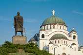 Serbia - Belgrade - Monument commemorating Karageorge Petrovich with white Saint Sava Cathedral behind