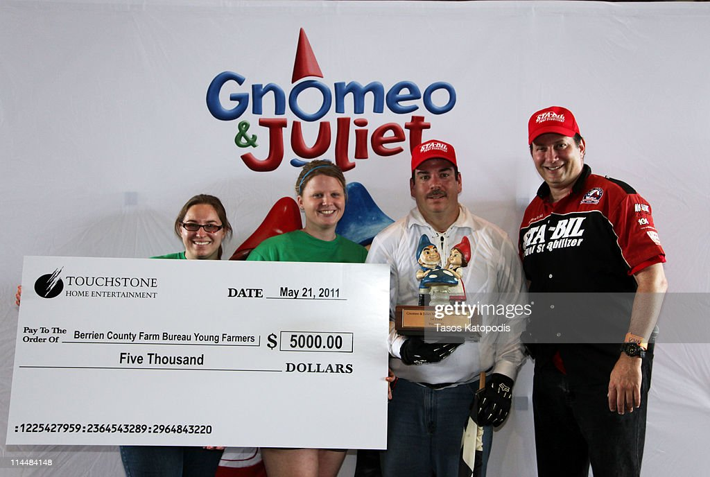 Karah Leitz, Amanda Morlock from the Berrien County Farm Bureau Young Farmers, winner Richard Webb, and Bruce Kaufman, President and of the U.S. Lawn Mower Racing Association, pose at the Gnomeo & Juliet Mow-down Showdown hilarious lawn mower race celebrating the film's May 24th Blu-ray Disc and DVD release at Berrien County Youth Fairgrounds on May 21, 2011 in Berrien Springs, Michigan.