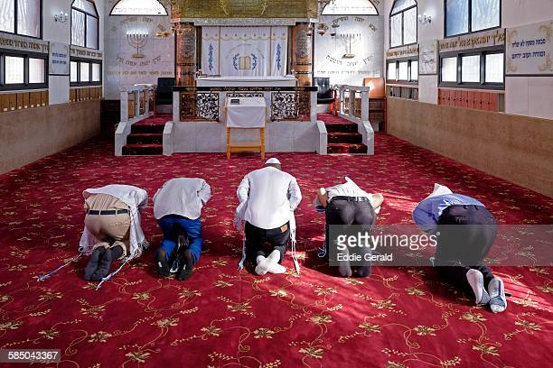 Karaite Jews bowing on the knees and prostrate during prayer in a Karaite synagogue in Ramle city in Israel on 21 September 2015 Karaite Jews who...