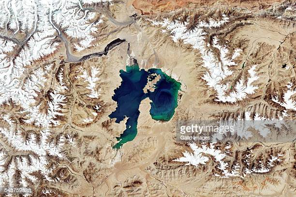 Karakul Lake lies inside an impact crater located in the Pamir Mountains in Tajikistan This image shows a wider view of the meteorite impact crater...