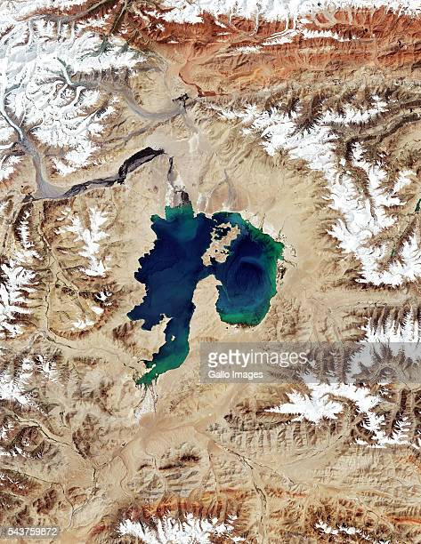 Karakul Lake lies inside an impact crater located in the Pamir Mountains in Tajikistan This image shows a satellite view of the meteorite impact...