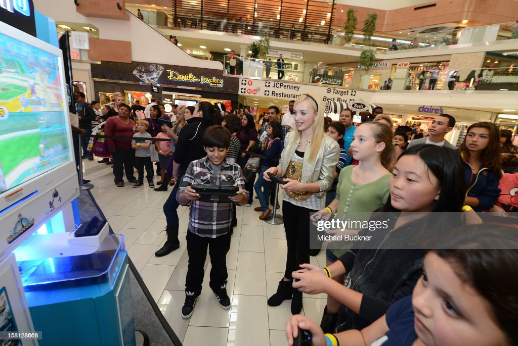 Karan Brar (L) and Peyton List stars of Disney Channel's hit series 'Jessie' battle in the Wii U Showdown at Westfield Century City Mall in Los Angeles on December 9, 2012. Wii U is one of Nintendo's hottest items of the holiday season.