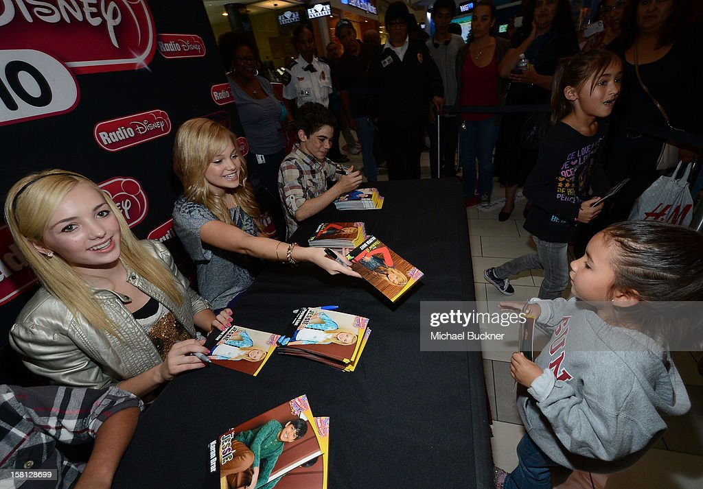 Karan Brar, Peyton List, Cameron Boyce and <a gi-track='captionPersonalityLinkClicked' href=/galleries/search?phrase=Olivia+Holt&family=editorial&specificpeople=7563645 ng-click='$event.stopPropagation()'>Olivia Holt</a> stars of the hit series 'Jessie' gets signs autographs for Radio Disney AM 1110 fans at the Wii U Showdown at Westfield Century City Mall in Los Angeles on December 9, 2012. Wii U is one of Nintendo's hottest items of the holiday season.