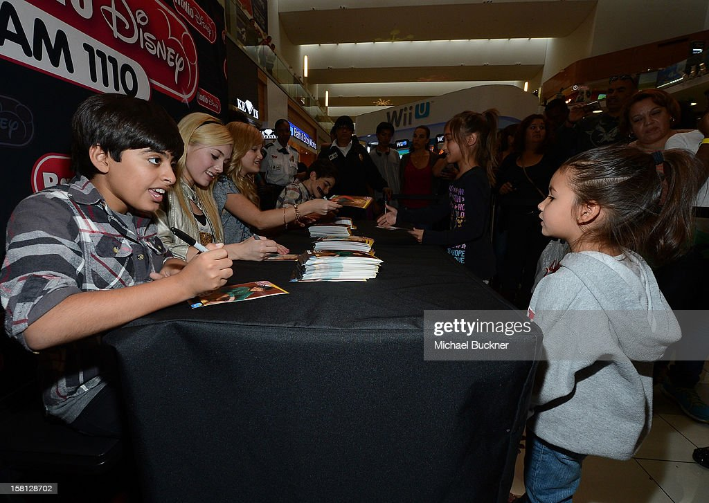 Karan Brar, Peyton List, Cameron Boyce and Olivia Holt stars of the hit series 'Jessie' gets signs autographs for Radio Disney AM 1110 fans at the Wii U Showdown at Westfield Century City Mall in Los Angeles on December 9, 2012. Wii U is one of Nintendo's hottest items of the holiday season.