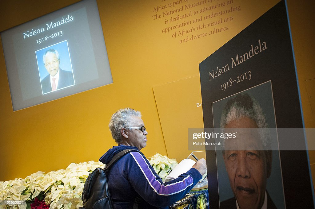 Karan Buster, 62, of Washington, D.C., signs a condolence book for Nelson Mandela at The National Museum of African Art on December 6, 2013 in Washington, DC. Mandela was a leader that helped conquer apartheid in racially divided South Africa after being jailed for his activism for decades. He was South Africa's first black president. He died yesterday at the age of 95.
