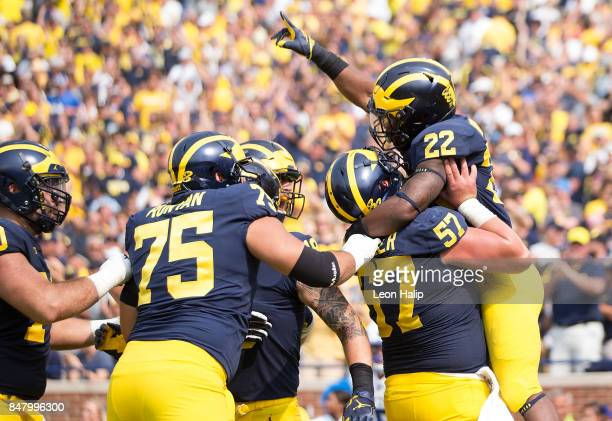 Karan Higdon of the Michigan Wolverines celebrates after scoring a fourth quarter touchdown during the game against the Air Force Falcons at Michigan...