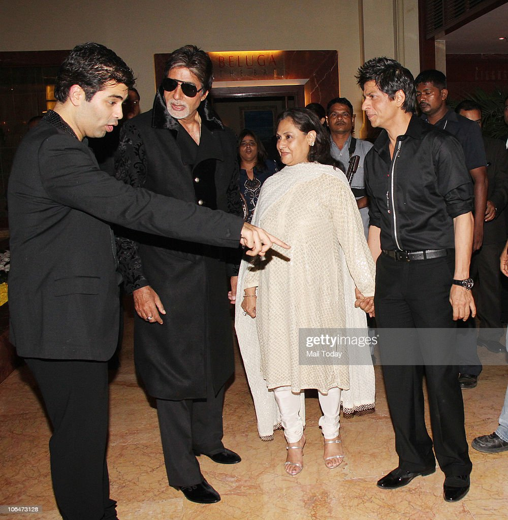 Karan Johar with Amitabh and <a gi-track='captionPersonalityLinkClicked' href=/galleries/search?phrase=Jaya+Bachchan&family=editorial&specificpeople=1026829 ng-click='$event.stopPropagation()'>Jaya Bachchan</a> and <a gi-track='captionPersonalityLinkClicked' href=/galleries/search?phrase=Shah+Rukh+Khan&family=editorial&specificpeople=664337 ng-click='$event.stopPropagation()'>Shah Rukh Khan</a> at designer Shabina Khan's birthday party in Mumbai on November 2, 2010.