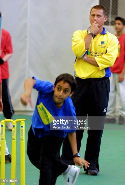 Karanveer Chhokar age 12 from Cranford Community College bowls as Darren Gough England Cricket player helps out with coaching at the Middlesex County...
