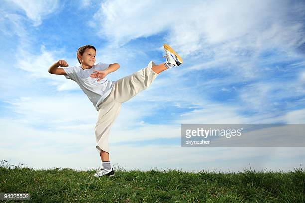Karate Boy on meadow