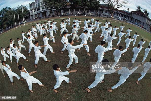 A karate drill for a class at Chung Ling High School in George Town Penang Malaysia December 1971 The boys' secondary school is selective and was...