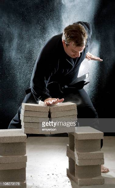 Karate Man Breaking Cinder Blocks