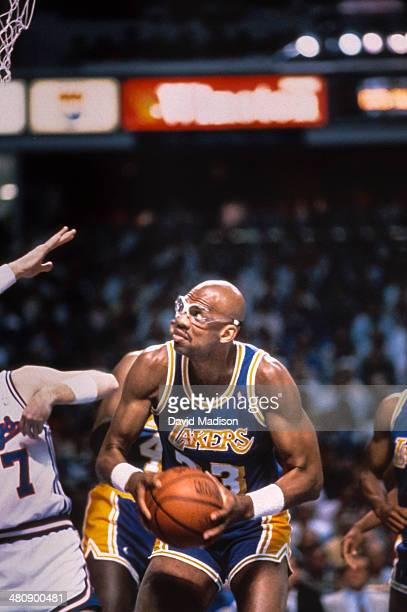 Kareem Abdul Jabbar of the Los Angeles Lakers attempts to shoot during an NBA game against the Sacramento Kings played on March 23 1989 at Arco Arena...