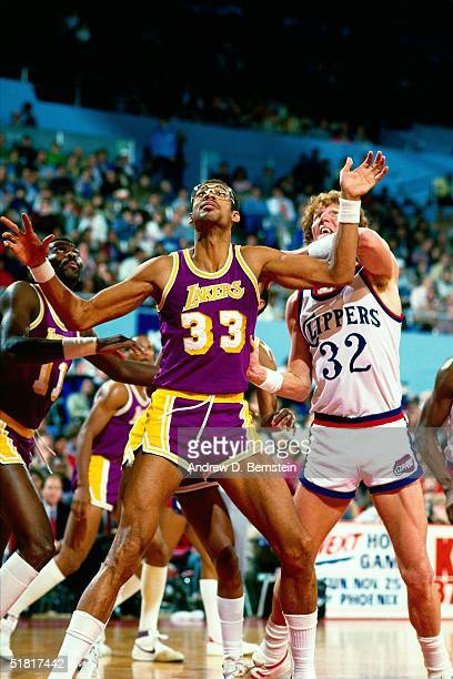 Kareem Abdul Jabbar of the Los Angeles Lakers battles for rebound position against the Bill Walton of the San Diago Clippers during an NBA game at...