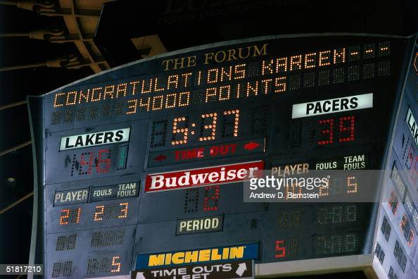 Kareem Abdul Jabbar of the Los Angeles Lakers gets acknowledged on the scoreboard for scoring 34000 points in his NBA career during an NBA game...