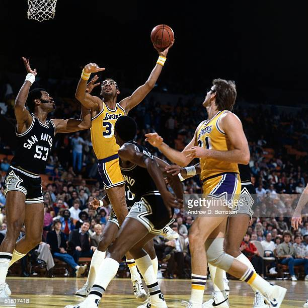 Kareem Abdul Jabbar of the Los Angeles Lakers goes up for a sky hook against the Artis Gilmore of the San Antonio Spurs during an NBA game circa 1983...