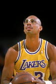 Kareem Abdul Jabbar of the Los Angeles Lakers makes a free throw during a game Mandatory Credit Stephen Dunn /Allsport