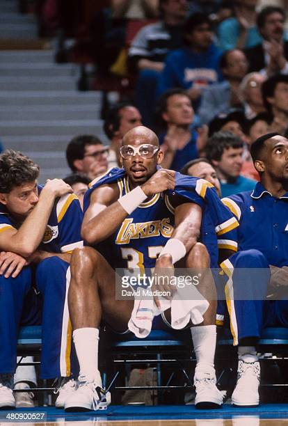 Kareem Abdul Jabbar of the Los Angeles Lakers sits on the bench during an NBA game against the Sacramento Kings played on March 23 1989 at Arco Arena...