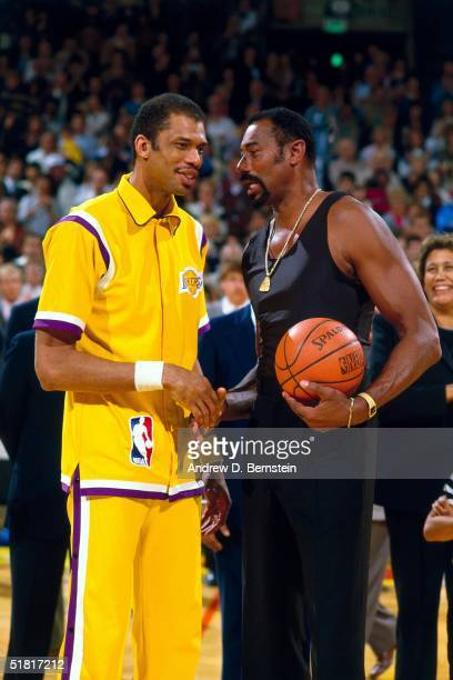 Kareem Abdul Jabbar of the Los Angeles Lakers talks with Wilt Chamberlain on the court prior to playing an NBA game against the Kansas City Kings on...