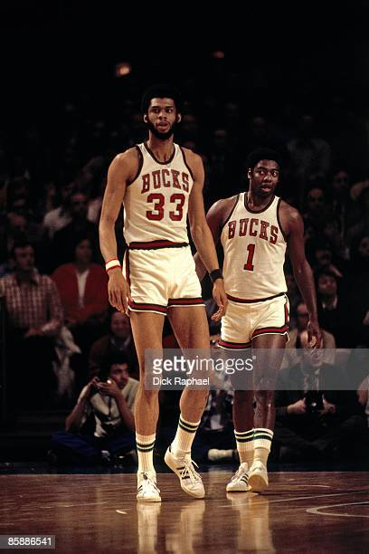 Kareem AbdulJabbar and Oscar Robertson of the Milwaukee Bucks walk on the court during the NBA Finals played in 1974 at the Milwaukee Arena in...