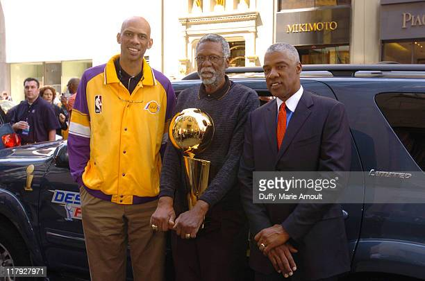 Kareem AbdulJabbar Bill Russel and Julius Erving with the 2005 Larry O'Brien NBA Championship Trophy