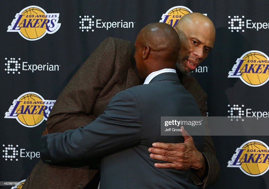 Kareem Abdul-Jabbar congratulates Byron Scott on becoming the new head coach of the Los Angeles Lakers during a press conference at Toyota Sports Center on July 29, 2014 in El Segundo, California.
