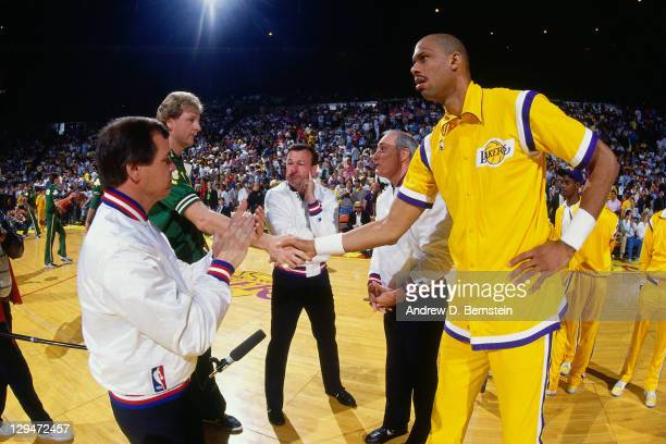 Kareem AbdulJabbar of the Los Angeles Lakers and Larry Bird of the Boston Celtics shake hands prior to Game Six of the 1987 NBA Finals on June 14...