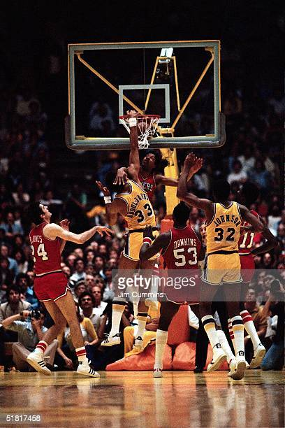 Kareem AbdulJabbar of the Los Angeles Lakers dunks on Julius Erving of the Philadelphia 76ers during Game 5 of the NBA Finals on May 14 1980 in...