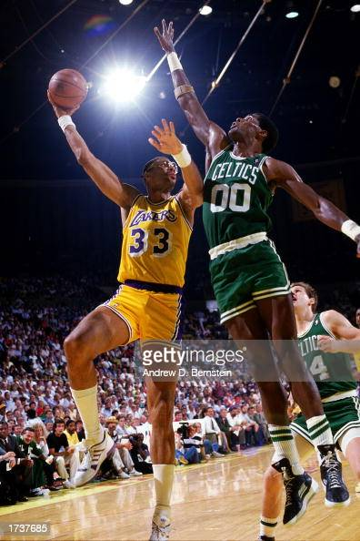 Kareem AbdulJabbar of the Los Angeles Lakers goes for a hook shot over Robert Parish of the Boston Celtics during the 1986 NBA game at the Forum in...