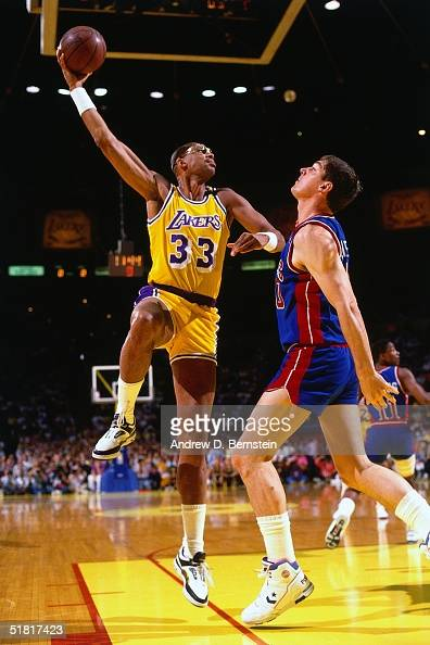 Kareem AbdulJabbar of the Los Angeles Lakers goes up for a sky hook against the Bill Laimbeer of the Detroit Pistons during an NBA game circa 1988 at...