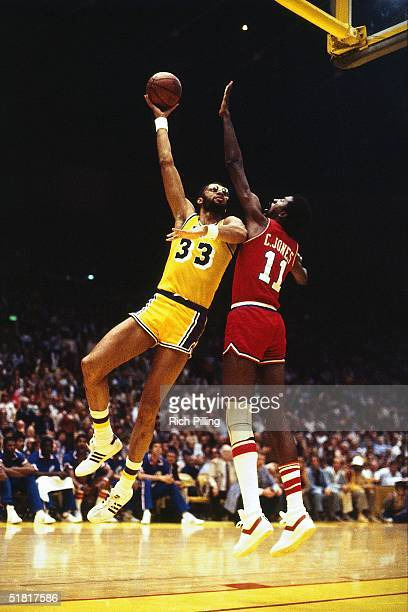 Kareem AbdulJabbar of the Los Angeles Lakers goes up for a sky hook against Caldwell Jones of the Philadelphia 76ers during a circa 1979 NBA game at...