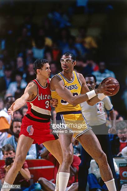 Kareem AbdulJabbar of the Los Angeles Lakers handles the ball against the Portland Trail Blazers during a game in 1984 at The Forum in Los Angeles...