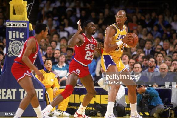 Kareem AbdulJabbar of the Los Angeles Lakers holds the ball in the post during an NBA game against the Philadelphia 76ers at the Great Western Forum...