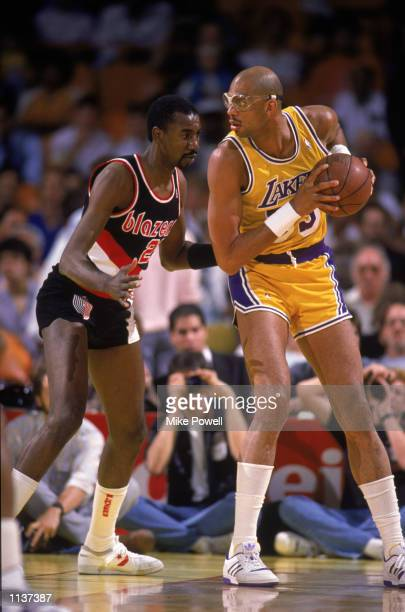 Kareem AbdulJabbar of the Los Angeles Lakers holds the ball in the post during an NBA game against the Portland Trail Blazers at the Great Western...