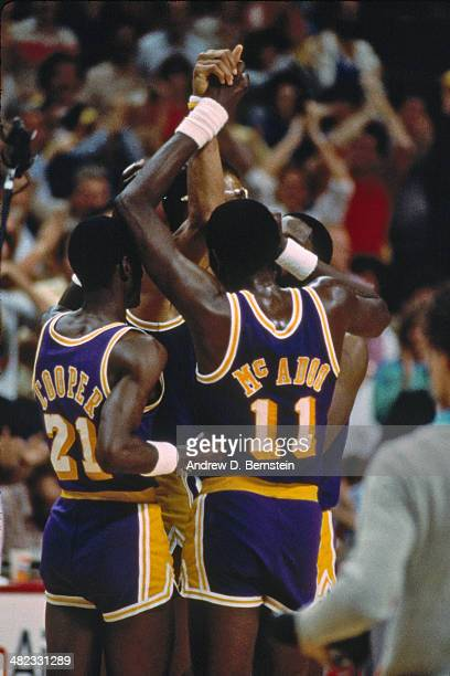 Kareem AbdulJabbar of the Los Angeles Lakers is congratulated during a game against the Utah Jazz at the Thomas and Mack Center on April 5 1984 in...