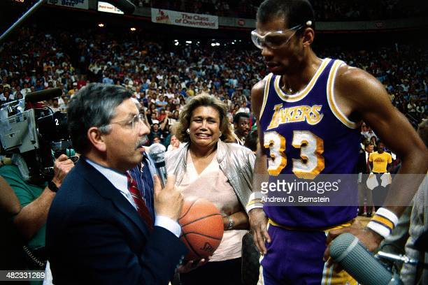 Kareem AbdulJabbar of the Los Angeles Lakers is greeted by NBA Commissioner David Stern during a game against the Utah Jazz at the Thomas and Mack...