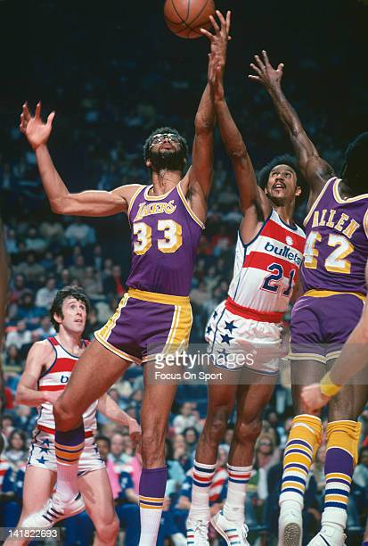 Kareem AbdulJabbar of the Los Angeles Lakers looks to grab the rebound away from Dave Bing of the Washington Bullets during an NBA basketball game...