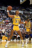 Kareem AbdulJabbar of the Los Angeles Lakers looks to pass the ball during an NBA game at the Great Western Forum in Los Angeles California in 1987