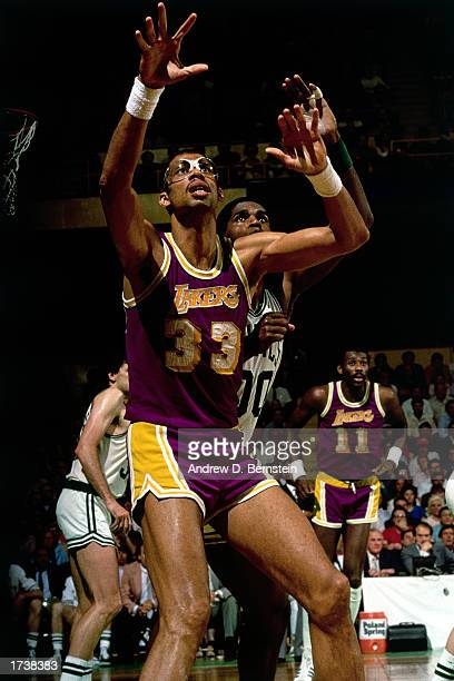 Kareem AbdulJabbar of the Los Angeles Lakers posts up against Robert Parish of the Boston Celtics during the 1984 NBA game at the Boston Garden in...