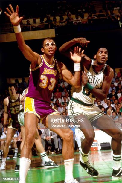 Kareem AbdulJabbar of the Los Angeles Lakers posts up against Robert Parish of the Boston Celtics during a game in 1984 at the Boston Garden in...
