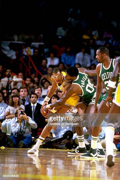 Kareem AbdulJabbar of the Los Angeles Lakers posts up against Robert Parish of the Boston Celtics during a game in 1984 at the Great Western Forum in...