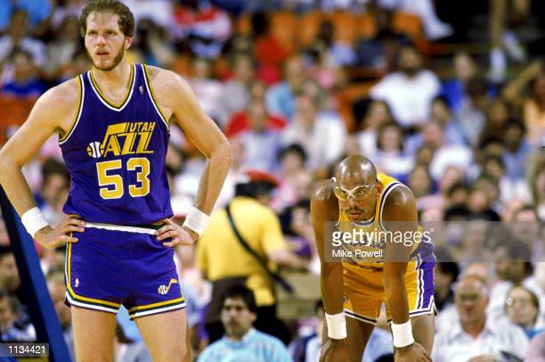 Kareem AbdulJabbar of the Los Angeles Lakers rests next to Mark Eaton of the Utah Jazz during an NBA game at the Great Western Forum in Los Angeles...