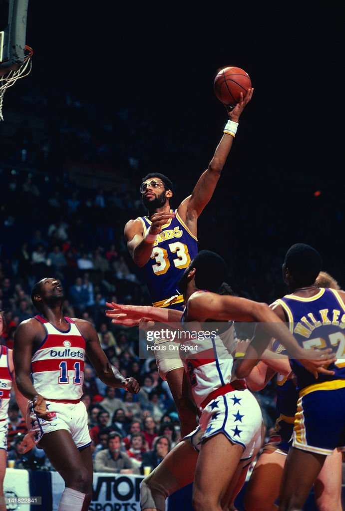 Kareem AbdulJabbar of the Los Angeles Lakers shoots a hook shot over Elvin Hayes of the Washington Bullets during an NBA basketball game circa 1983...