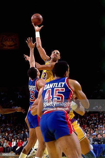 Kareem AbdulJabbar of the Los Angeles Lakers shoots a sky hook against James Edwards and Adrian Dantley of the Detroit Pistons February 14 1989 at...