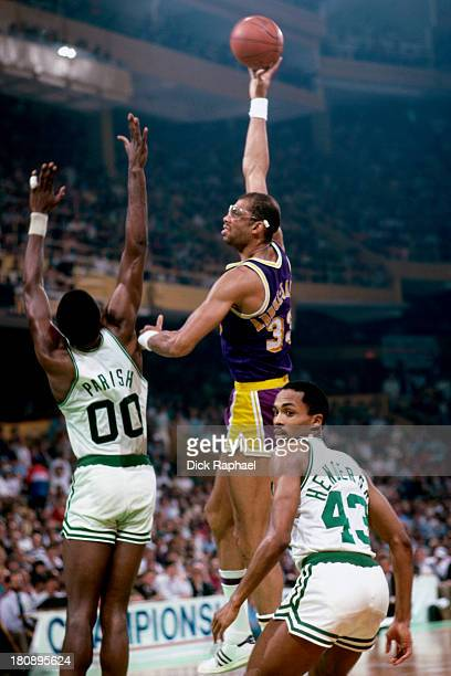 Kareem AbdulJabbar of the Los Angeles Lakers shoots over Robert Parish of the Boston Celtics during a game circa 1984 at the Boston Garden in Boston...