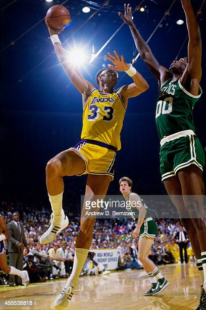 Kareem AbdulJabbar of the Los Angeles Lakers shoots the ball against Robert Parish of the Boston Celtics during a game in 1984 at the Great Western...
