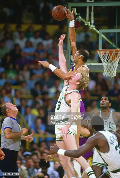 Kareem AbdulJabbar of the Los Angeles Lakers wins a jump ball over Larry Bird of the Boston Celtics during the 1985 NBA Basketball Finals at the...