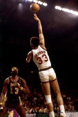 Kareem AbdulJabbar of the Milwaukee Bucks attempts a hook shot against Wilt Chamberlain of the Los Angeles Lakers during a 1972 NBA game at the...
