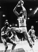 Kareem AbdulJabbar of the Milwaukee Bucks battles for a rebound against Wilt Chamberlain of the Los Angeles Lakers in Milwaukee WI 1971 NOTE TO USER...