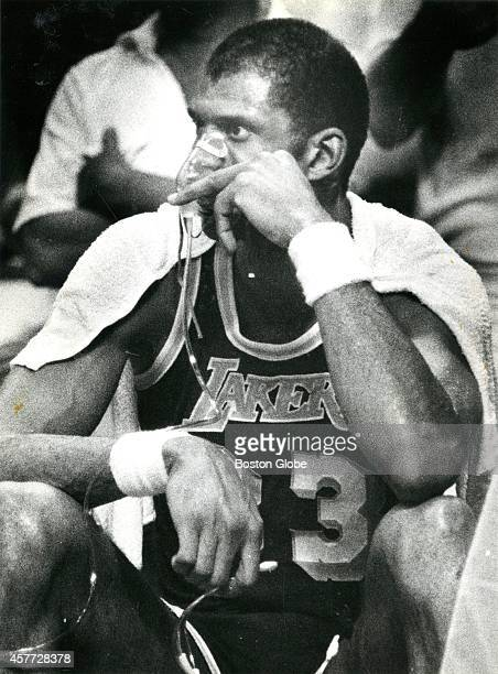 Kareem AbdulJabbar sits on the bench with an oxygen mask as the Los Angeles Lakers faced off against the Boston Celtics in Game 5 of the NBA Finals